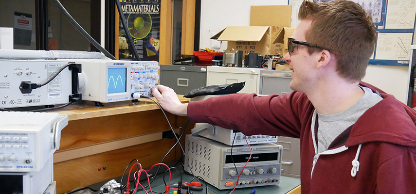 Electronics student working in the lab.