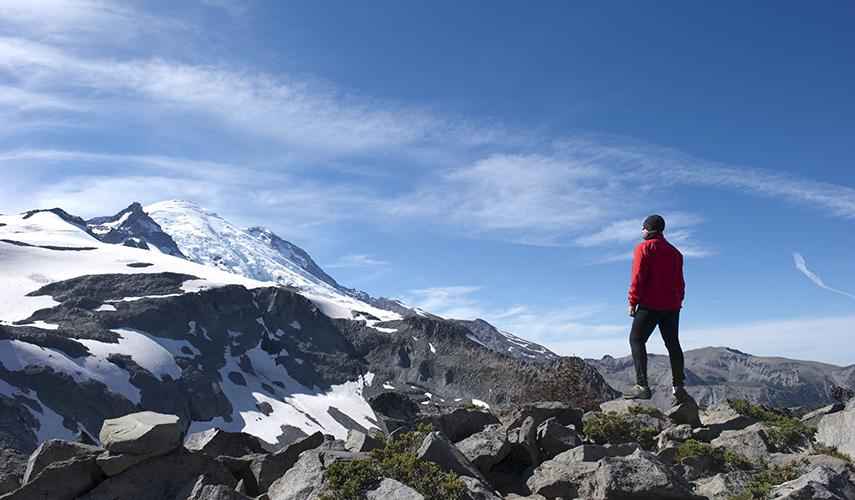 A geologist stands atop Mt. Rainier