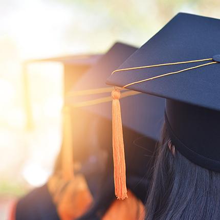Graduation Caps against the sunset