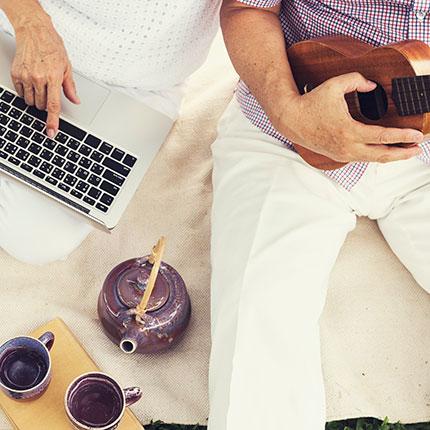 Couple with laptop and ukulele