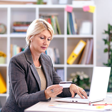 Female woman in business suit working on a laptop