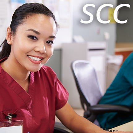 Medical office specialist smiling at the camera