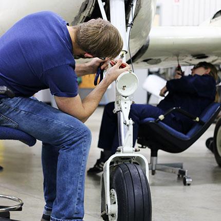 Student working on landing gear.