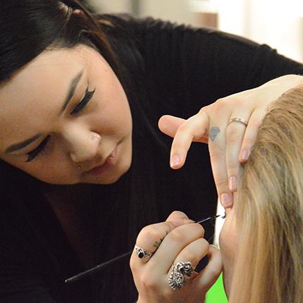 Applying makeup at SCC.
