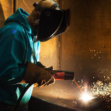 Welding student working.