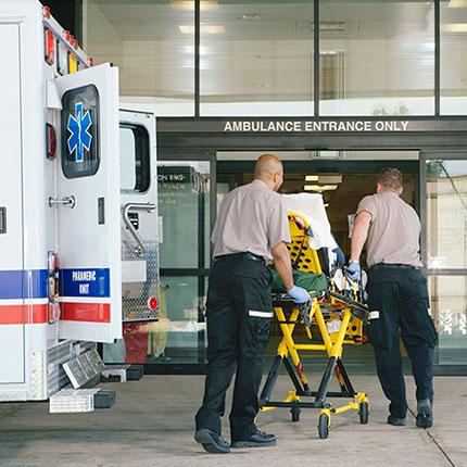 EMT professionals transferring a patient.