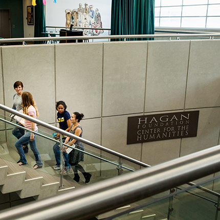 Students walking up the stairs at the Hagan Foundation Center for Humanities