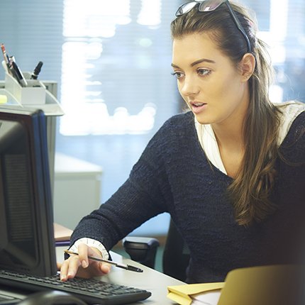 Woman working at a desk.