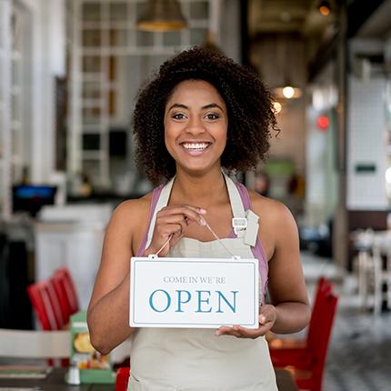 Entrepreneur woman holding an open sign.