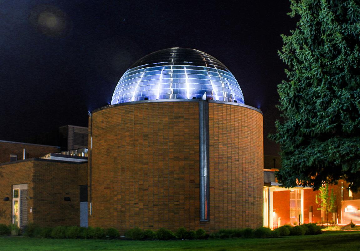 The SFCC Planetarium building pictured at night