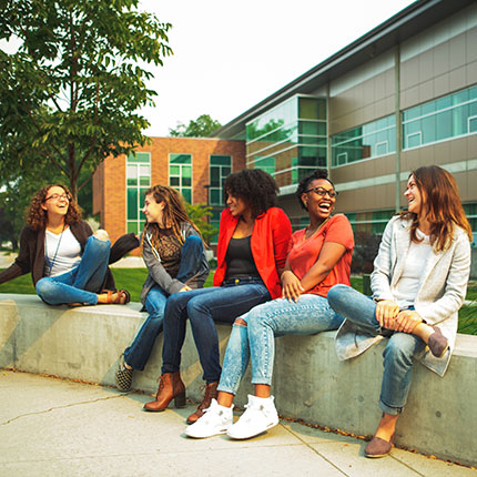 A group of SFCC students sitting outside and socializing