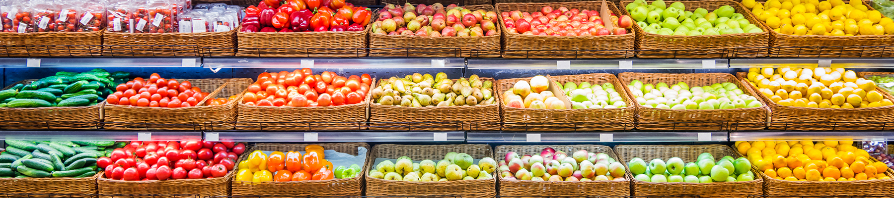 Fresh vegetables displayed in baskets at a store