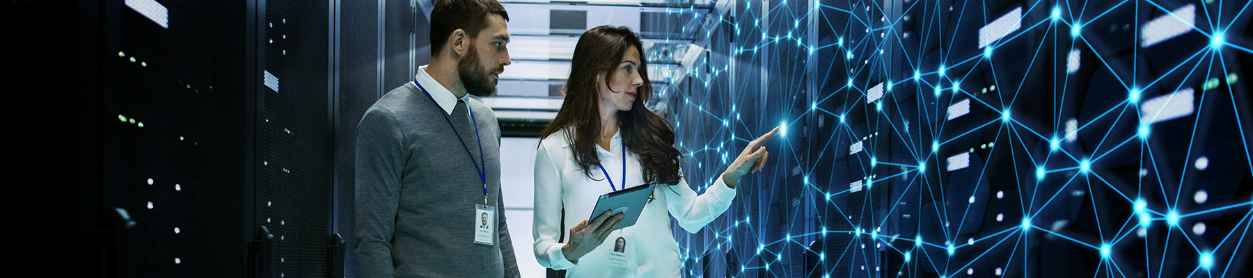 Male and female walking through server room