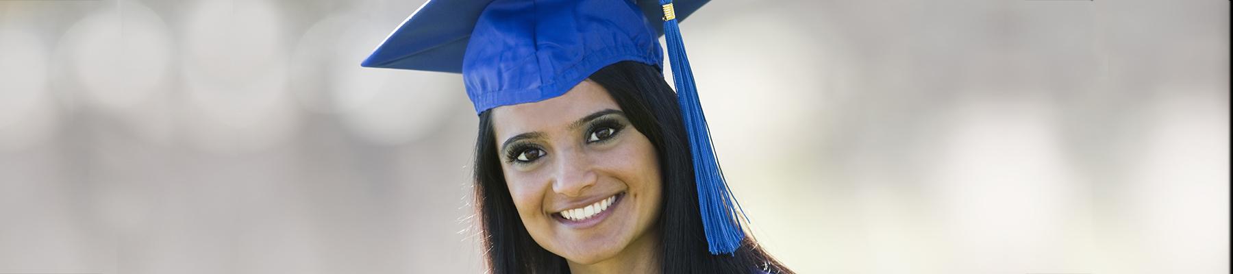 Femal Graduate in cap and gown