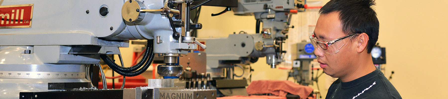 A Student Operating a Manufacturing Machine