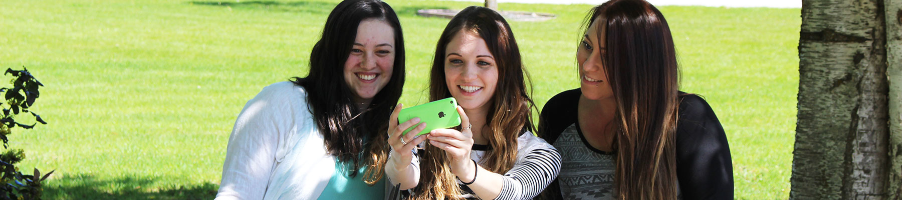 three female students taking selfie