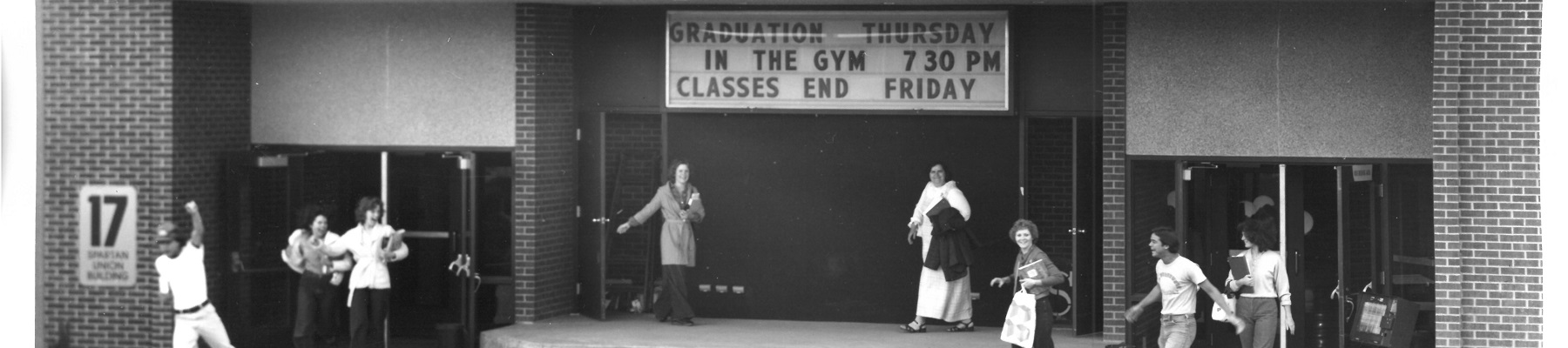 Students exiting the student union building in the 1970s black and white