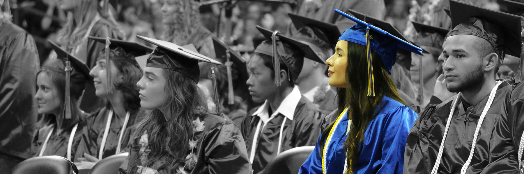 An SFCC student seated during the 2017 Community Colleges of Spokane graduation ceremony.