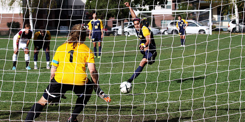 Men's soccer team on a penalty kick.