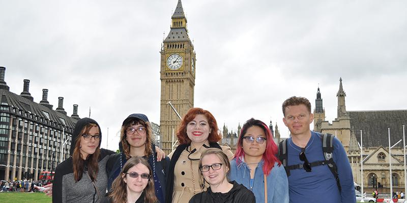 A group of 7 students facing the camera, behind them is the Big Ben clocktower in London.