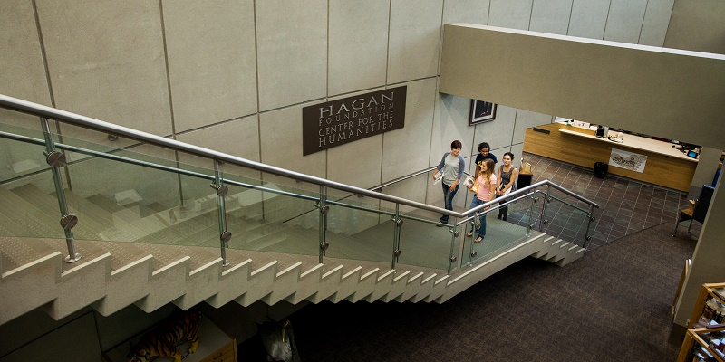 Four students walking upstairs in SCC library