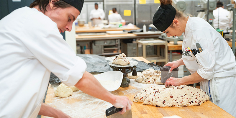 2 students making bread.