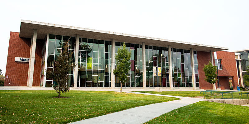 Outdoor view of the music building in early fall.