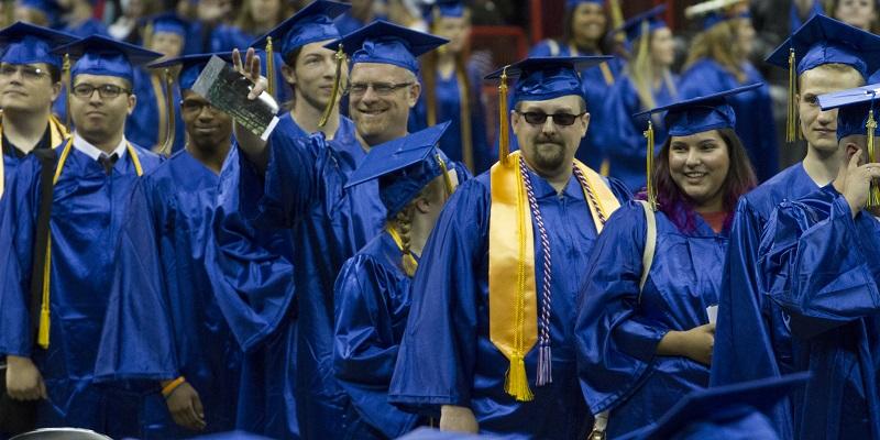 Graduates filing into seats at ceremony