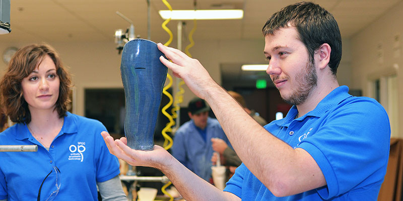 Students work with a prosthetic