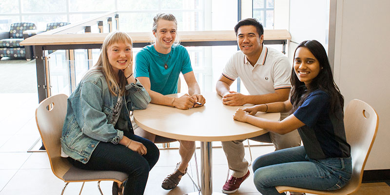 Students sitting at a table in the Gateway Building