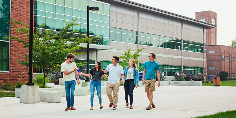 A group of students walking on the SFCC campus