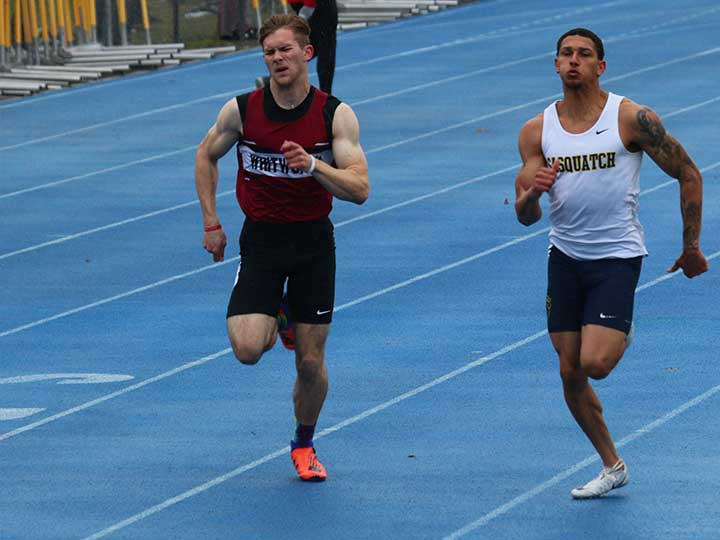 Men's track and field opponents sprinting to the finish