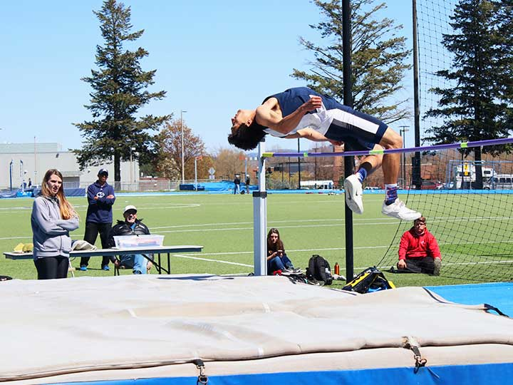 Men's Track and Field high jump midair