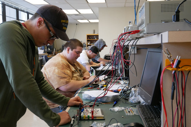 Electronics students testing in the lab.