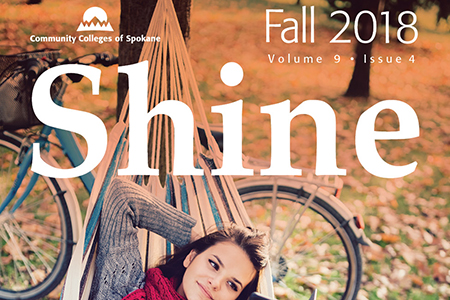 "The word ""Shine"" over Fall scene with leaves, bike and hammock"