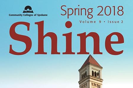 "The word ""Shine"" over Spokane clock tower"