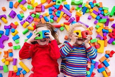 Kids looking through color blocks