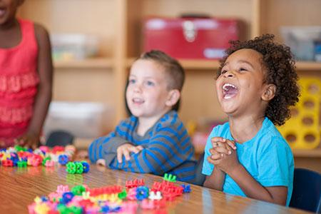 Children laughing in preschool