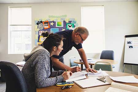 Republic Professor helping a Student