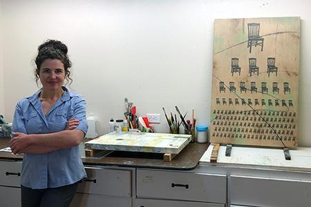 Sam Marroquin standing in her studio