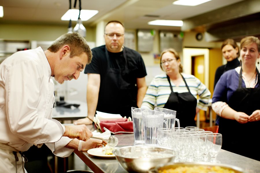 Instructor showing group of students plating