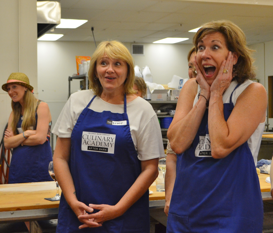 Two women surprised in teaching kitchen